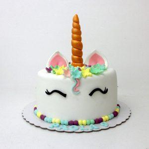 Tarta unicornio con flores fondant pastel